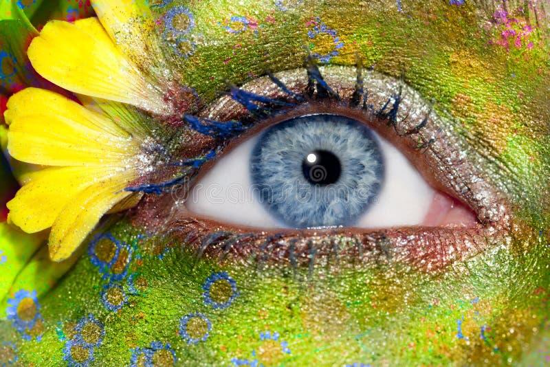 Blue woman eye makeup spring flowers metaphor royalty free stock images