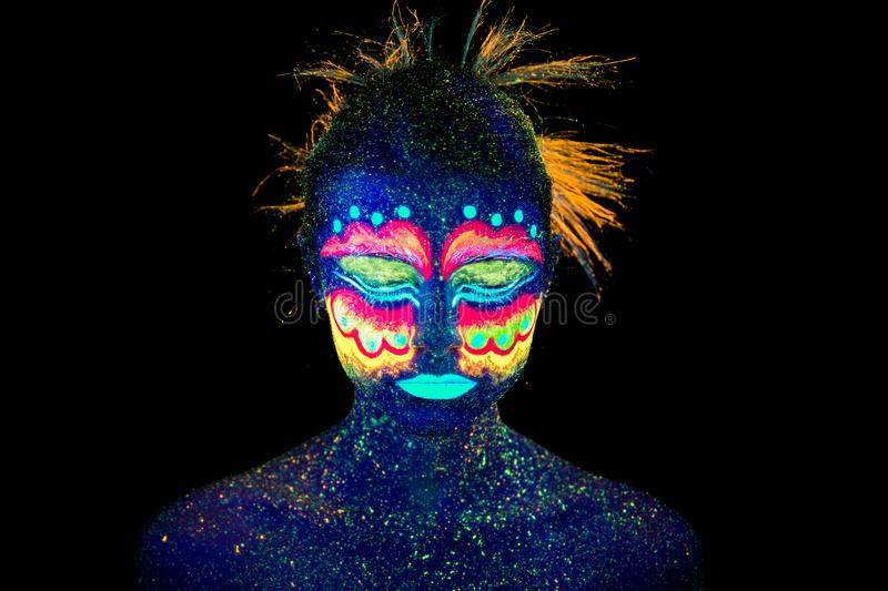 Blue woman portrait, aliens sleeps, ultraviolet make-up. Beautiful on a dark background. royalty free stock image