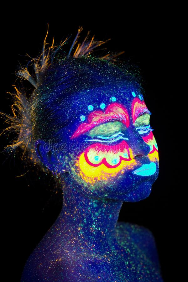 Blue woman portrait, aliens sleeps, ultraviolet make-up. Beautiful on a dark background. She closed her eyes royalty free stock image