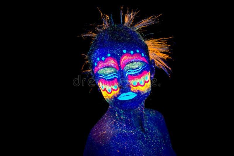 Blue woman portrait, aliens sleeps, ultraviolet make-up. Beautiful on a dark background. royalty free stock image