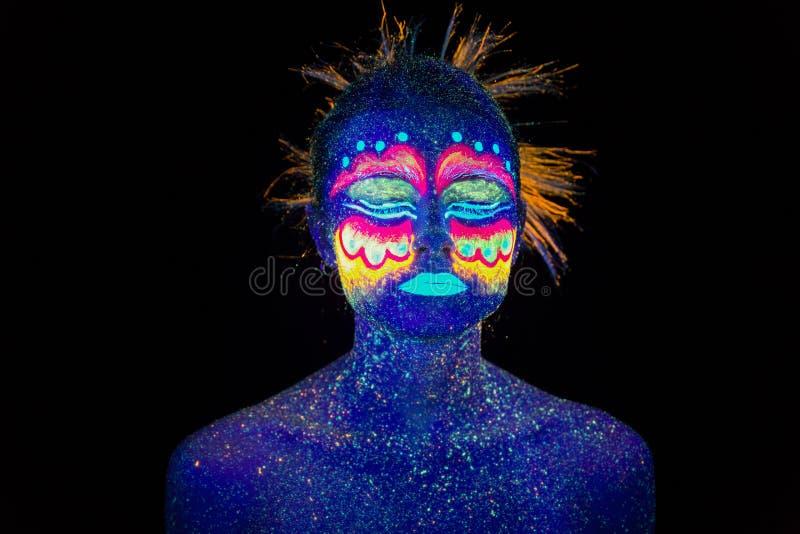 Blue woman portrait, aliens sleeps, ultraviolet make-up. Beautiful on a dark background. Full face portrait stock photo