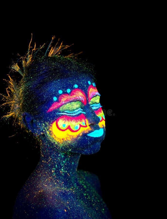Blue woman portrait, aliens sleeps, ultraviolet make-up. Beautiful on a dark background. stock photos