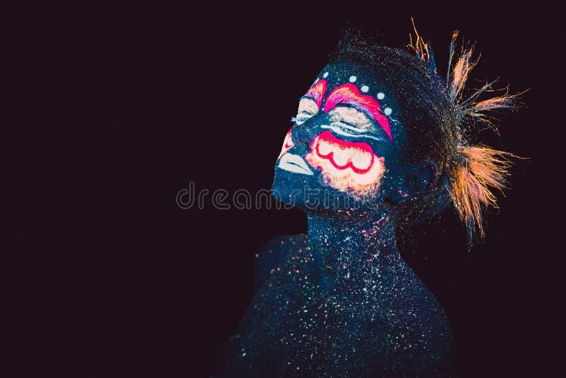 Blue woman portrait, aliens sleeps, ultraviolet make-up. stock images