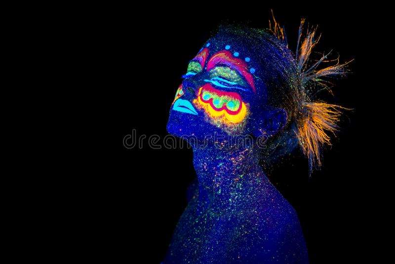 Blue woman portrait, aliens sleeps, ultraviolet make-up. stock photo