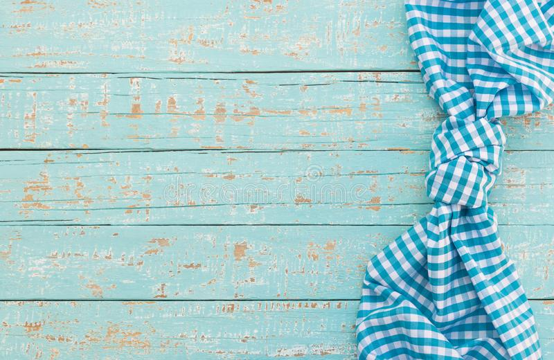 Mediterranean table background with blue checked tablecloth and copy space. Blue wood table background rustic texture, with blue checkered tablecloth, high angel royalty free stock photo