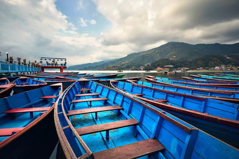 Blue wooden boats in Pokhara royalty free stock photography
