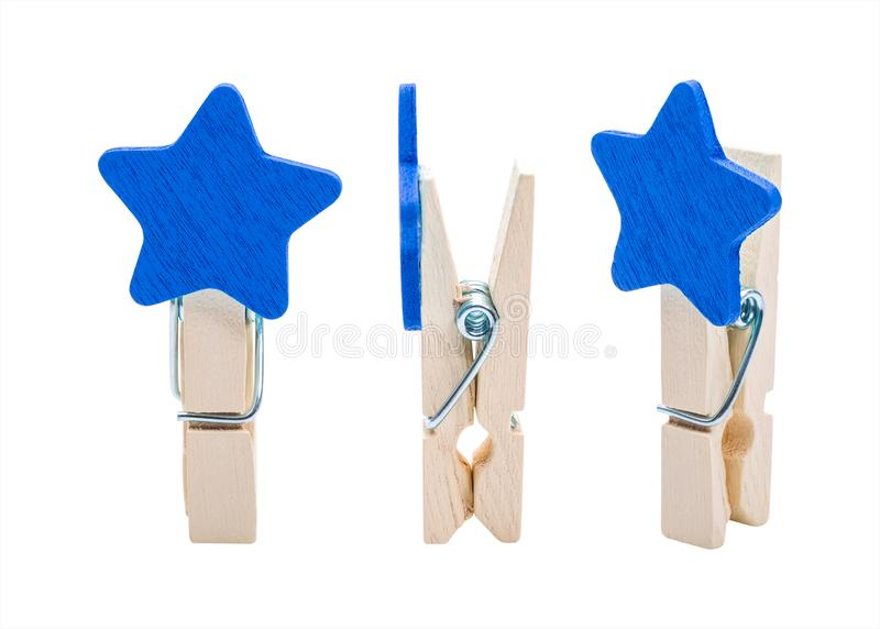 Blue Wooden clip isolated on white background. Colors clips in star shape.  Clipping path stock photography