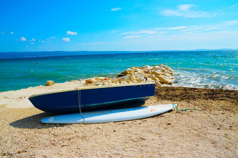 Blue Wooden Dinghy Boat Beside Body of Water royalty free stock photography