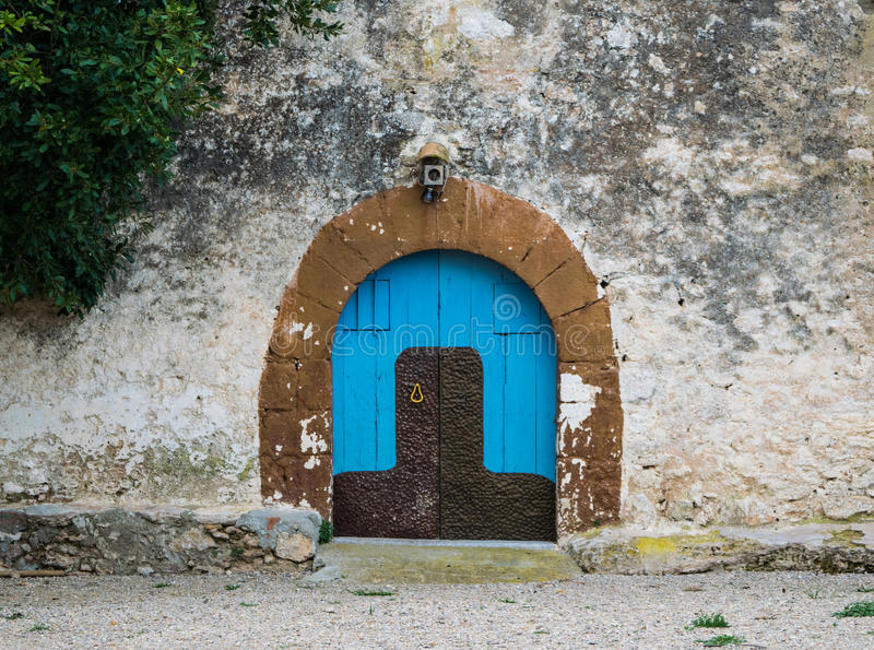 Blue wooden door in the old rural house royalty free stock photo