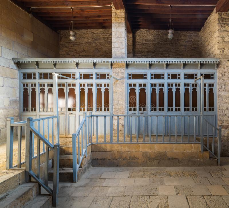 Blue wooden door shutters and balustrades at historical traditional Turkish public bathhouse stock photo