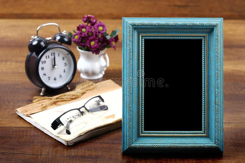 Blue wooden photo frame with item on wood. Travel and vacation background with clipping path stock image