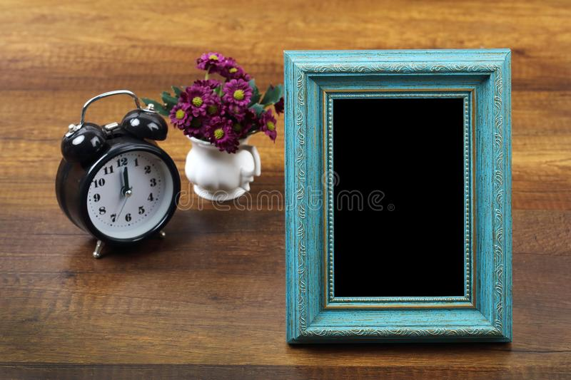 Blue wooden photo frame with item on wood. Travel and vacation background with clipping path stock photo