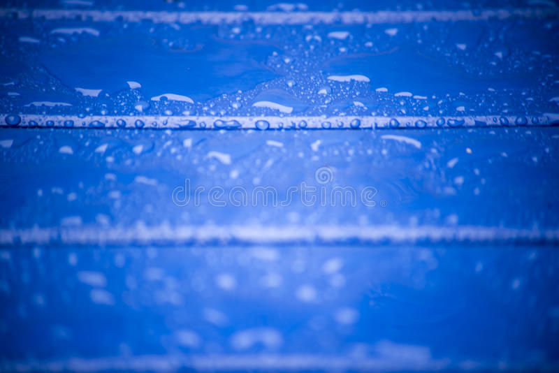 Blue wooden planks with rain drops royalty free stock image