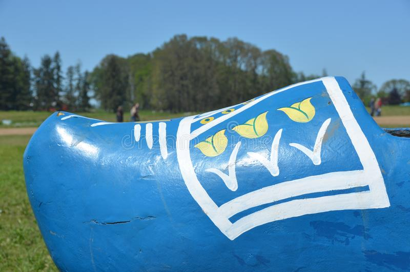Blue wooden shoe on tulip farm. This is a children`s ride in the form of a blue wooden shoe on the Wooden Shoe Tulip Farm near Woodburn, Oregon stock photography