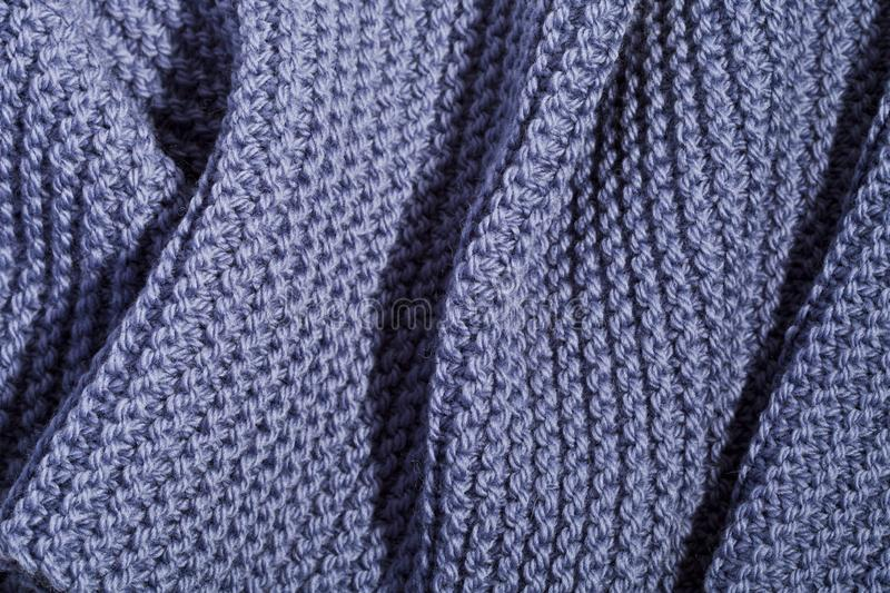 Blue wool knitted scarf. Blue wool knitted scarf closeup texture royalty free stock photography