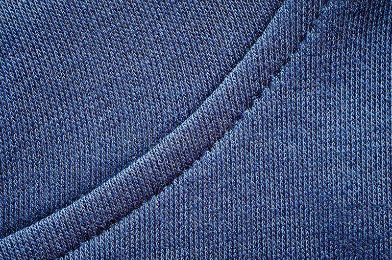 Blue wool yarn knitted texture with large stitches. Hand knitted ribbing stitch pattern stock photography