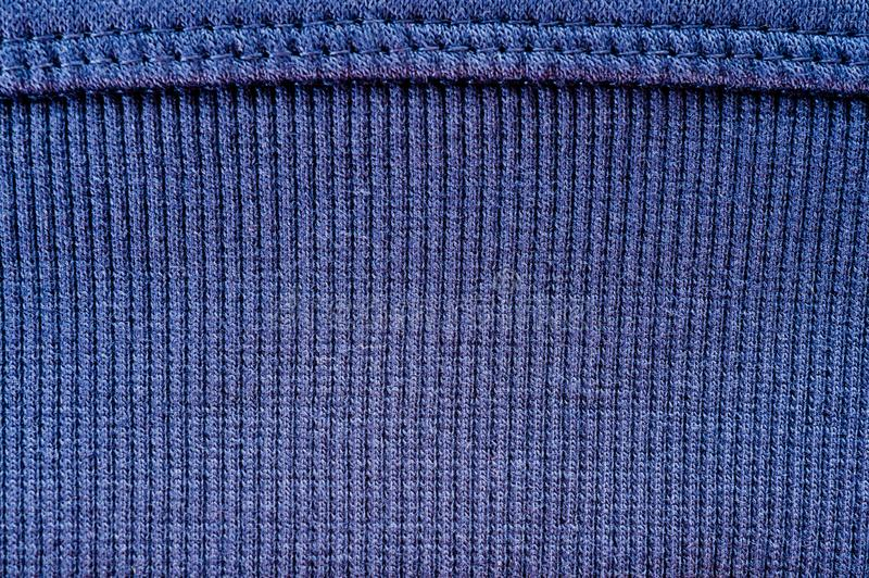 Blue wool yarn knitted texture with large stitches. Hand knitted ribbing stitch pattern stock images