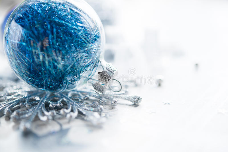 Blue xmas ornaments on bright holiday background. With space for text royalty free stock photos