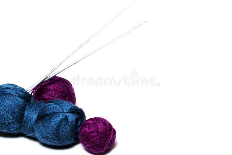 Blue yarn and knitting needles. Blue yarn balls with bamboo knitting needles royalty free stock photography