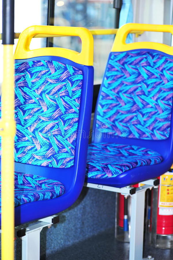 Blue and yellow bus seats stock image