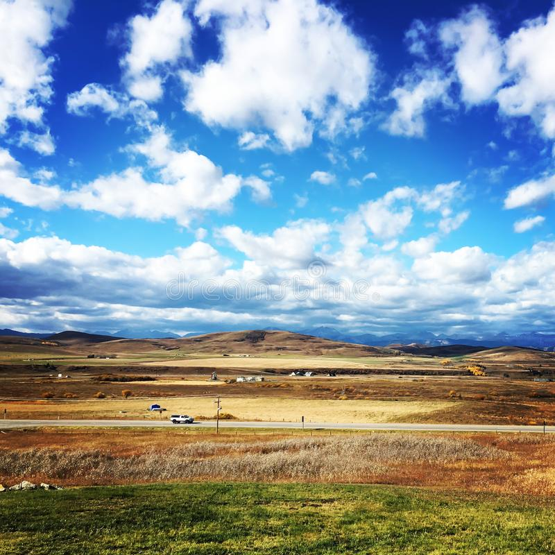 Blue, yellow and green landscape. royalty free stock photos