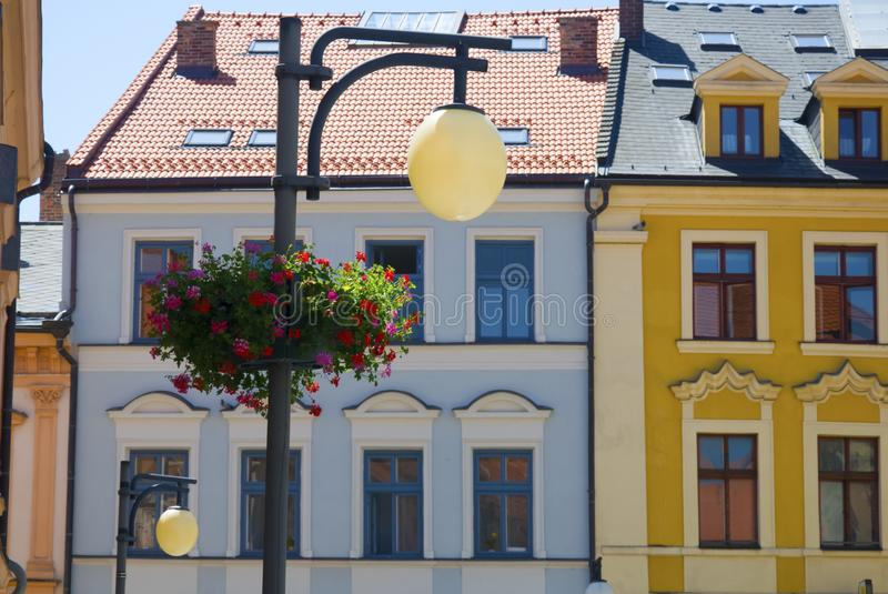 Blue and yellow houses facade with lamp and flower pot, summer. Czech Republic royalty free stock photo