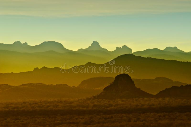 Sunset over rocky mountains in Arizona. Blue, yellow orange and turquoise sunset over rocky mountains range in Arizona stock photos