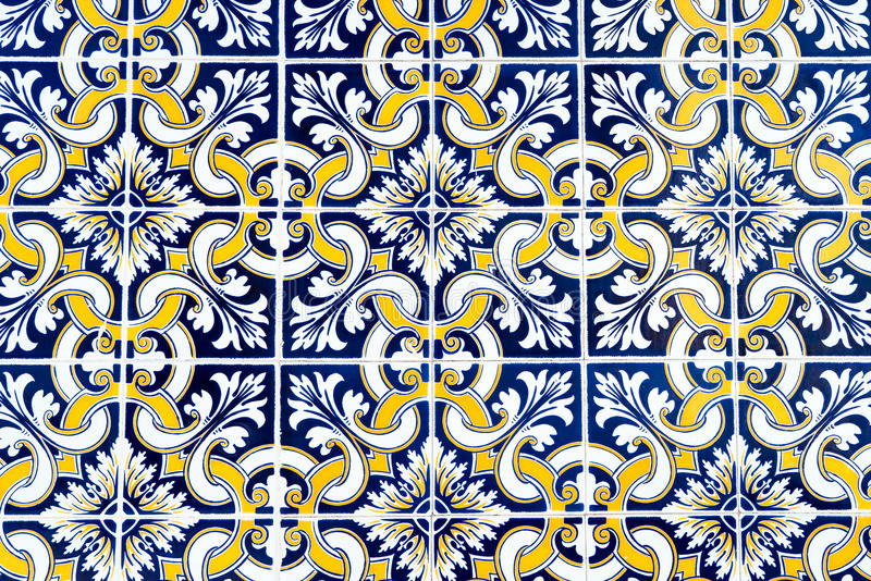 Blue and Yellow Patterned Portuguese Tiles. Blue and green patterned and textured porcelain tiles found in the city of Aveiro, Portugal royalty free stock images