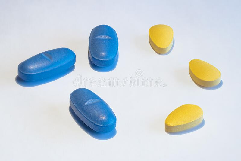 Blue and yellow Pills on white background. View of Blue and yellow Pills on white background royalty free stock photo