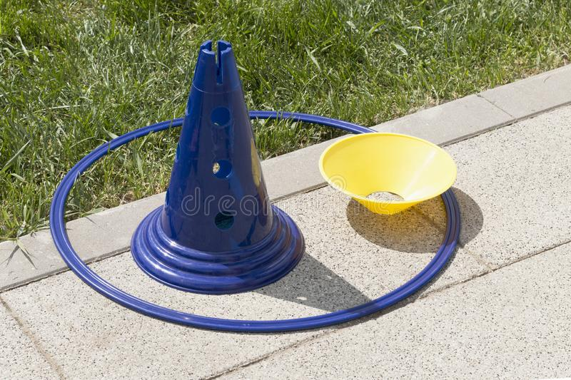 Blue and yellow plastic sport cones with blue hoop royalty free stock photo