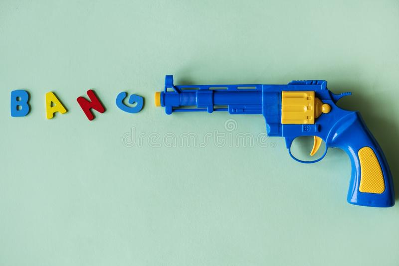 Blue and Yellow Plastic Toy Revolver Pistol royalty free stock photo