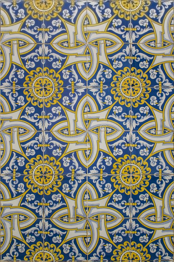 Blue and yellow portuguese mosaic. Made of ceramic tiles stock image