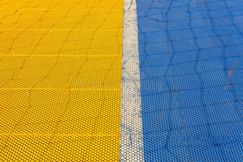 Download Blue And Yellow Rubber Flooring On Futsal Field Background Stock Photo