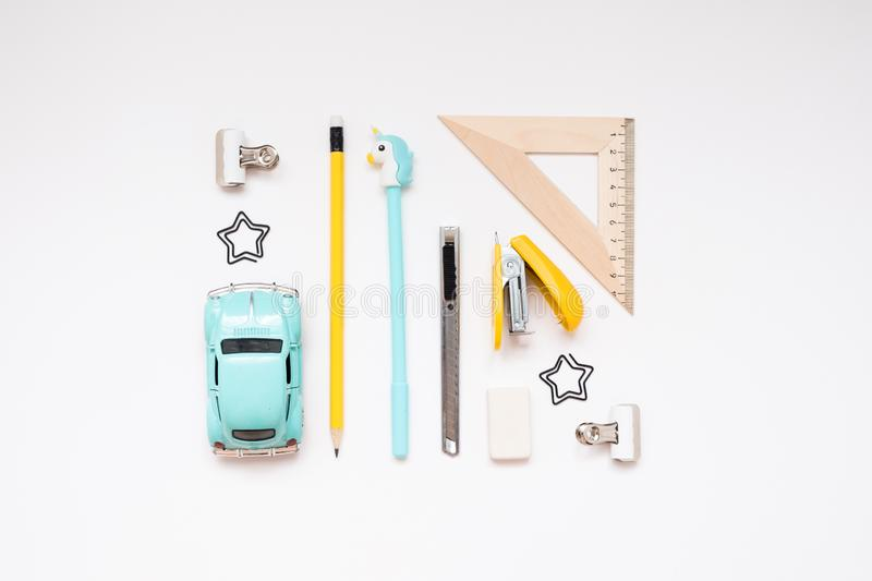 Blue and yellow school supplies isolated on white background. Back to school. Flat lay stock image