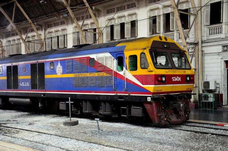 Blue and yellow Thai railways diesel electric locomotive parked at Bangkok train station Thailand royalty free stock images