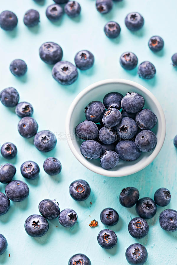Blueberries on blue background page layout royalty free stock photography