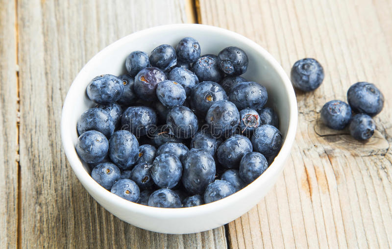 Blueberries in a bowl, healthy berry fruits in white bowl royalty free stock photography