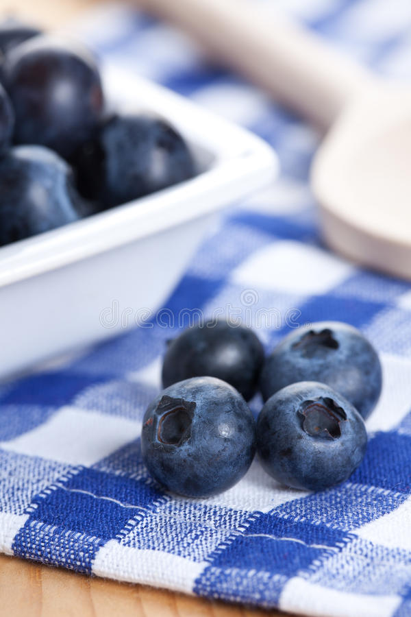 Blueberries On Checkered Tablecloth Stock Image