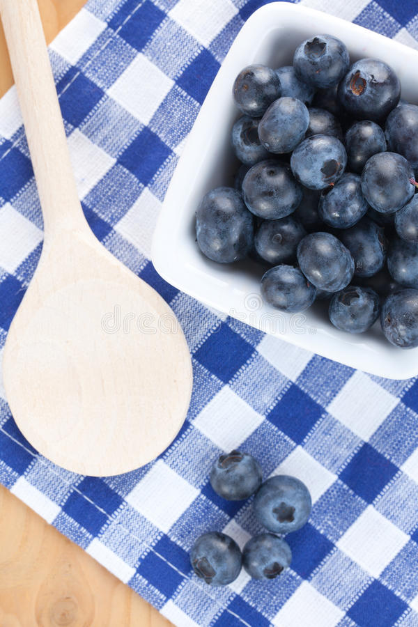 Blueberries on checkered tablecloth