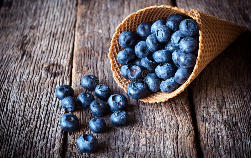 Blueberries in the cone royalty free stock photos