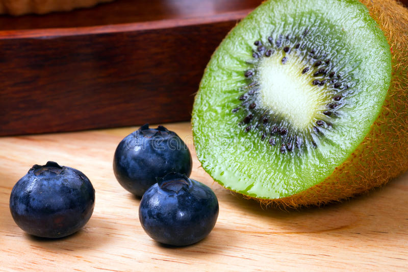 Download Blueberries And Half Of Kiwi Stock Photo - Image: 22883736