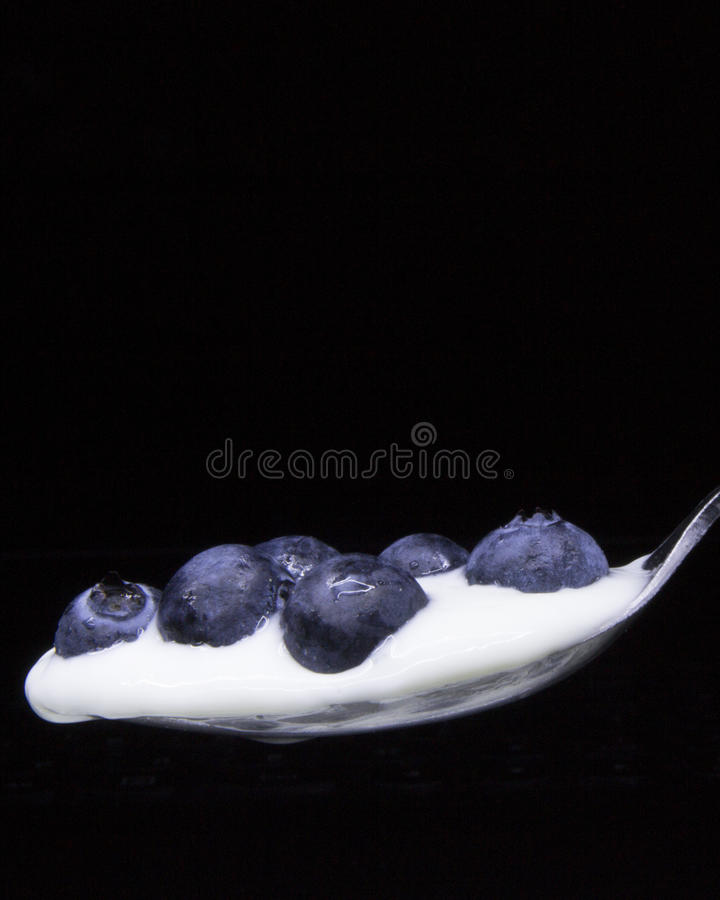 Free Blueberries In A Spoon Isolated On Black .Concept: Healthy Living,nutritions. Royalty Free Stock Image - 74347836