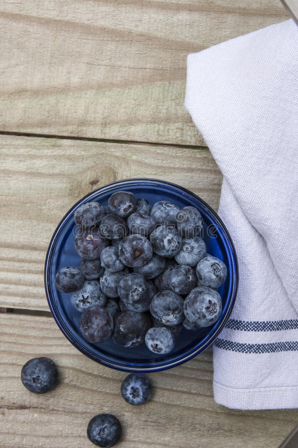 Blueberries on rustic table top royalty free stock photography