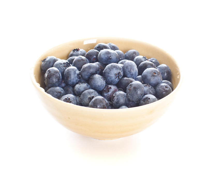 Download Blueberries Spilling Out Of A Bowl Stock Image - Image: 21589203
