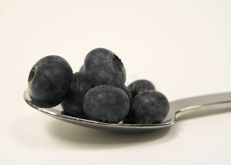 Blueberries on Spoon stock photography