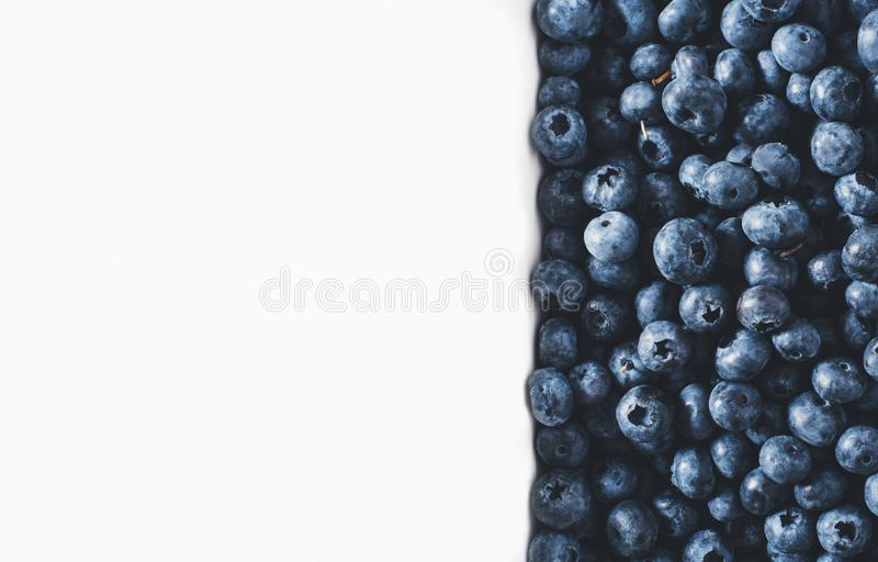 Blueberries on vintage wooden white background top view, healthy food on dark table mockup, berry for smoothie isolated on rustic royalty free stock photography