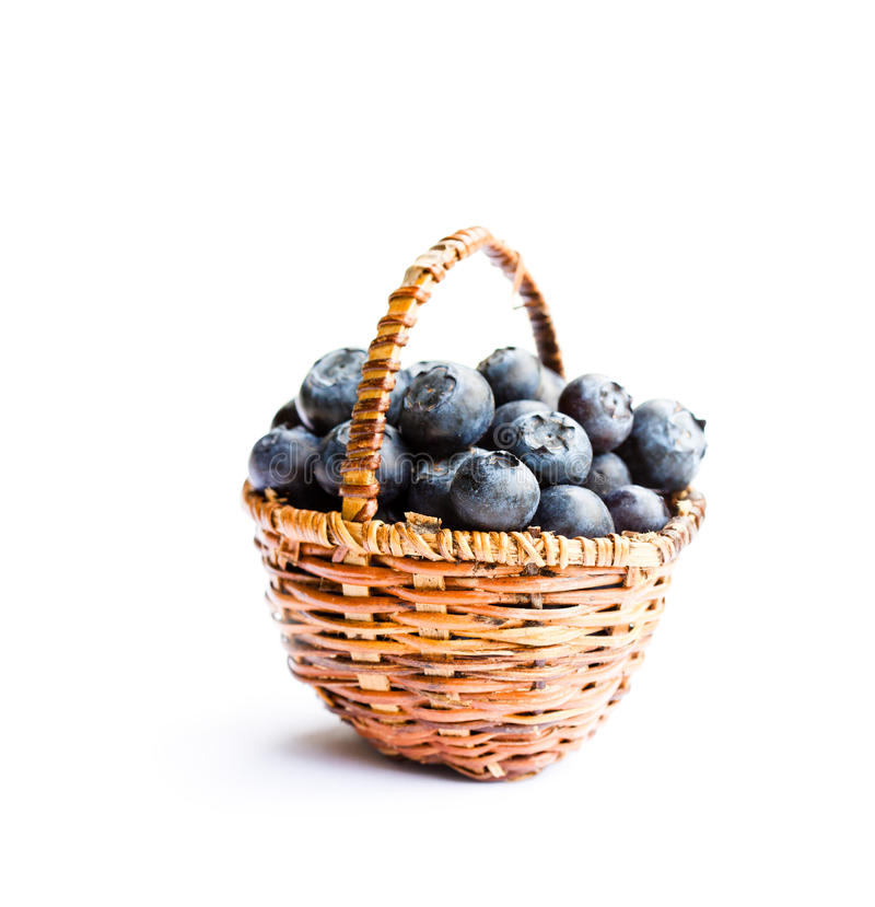 Blueberries in wicker basket isolated on white background stock photos