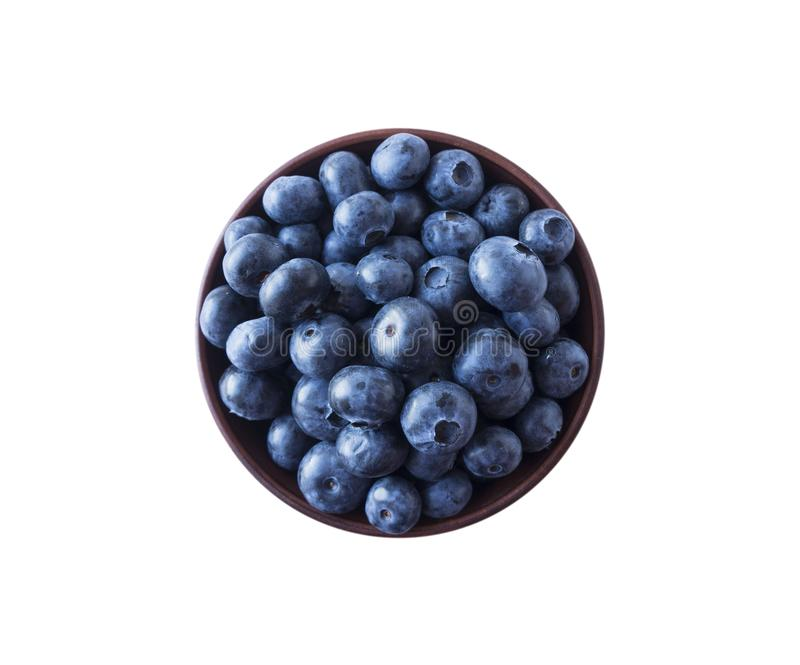 Blueberries in a wooden bowl. Ripe blueberries with copy space for text. Blueberry isolated on white. Bilberries  on a white backg. Round. Top view stock photos