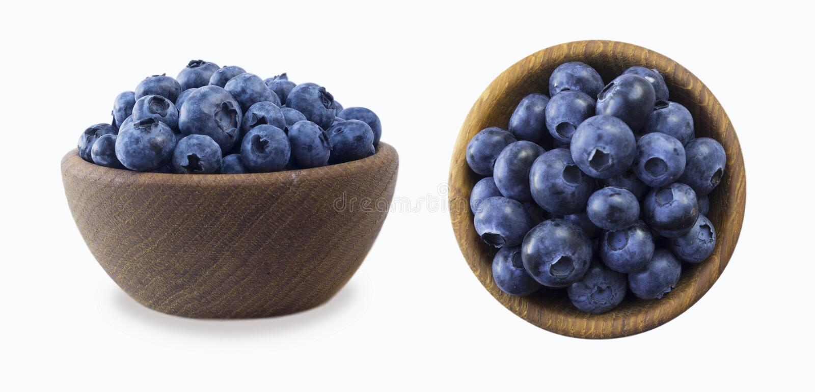 Blueberries in a wooden bowl. Ripe blueberries with copy space for text. Blueberry isolated on white. Bilberries on a white backg. Round. Top view. Blueberries stock photography