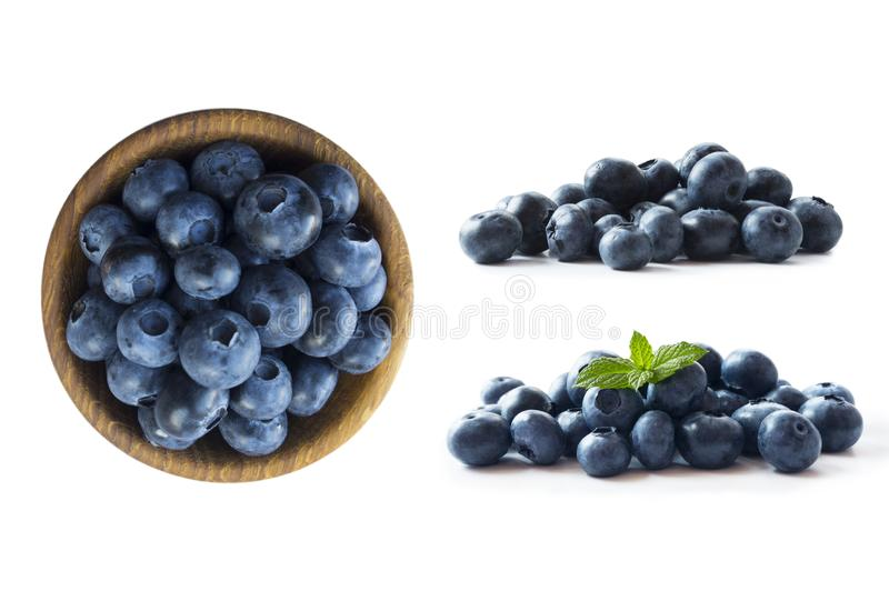 Blueberries in a wooden bowl. Ripe blueberries with copy space for text. Blueberry isolated on white. Bilberries  on a white backg. Round. Top view. Blueberries stock photo
